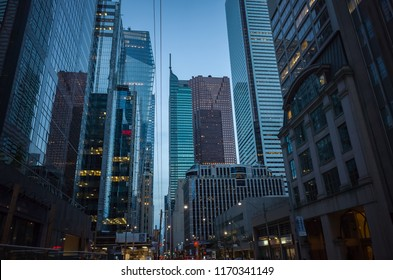 TORONTO, CANADA - SEPTEMBER 01, 2018: Skyscrapers in the Financial District of Toronto from below at dusk