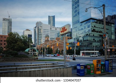 TORONTO, CANADA - SEPTEMBER 01, 2018:  Queens Park TTC Subway station and the nearby buildings in evening