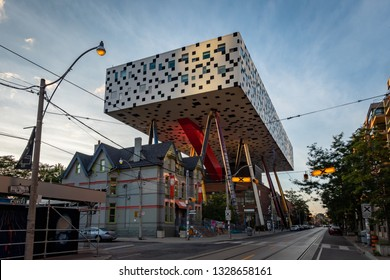 TORONTO, CANADA - SEPTEMBER 03 2018: OCAD University building top illuminated at sunset on a vibrant blue  cloudy sky background