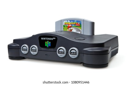 Toronto, Canada - September 10, 2012: This is a studio shot of a Nintendo 64 game console and Mario Kart game isolated on a white background.