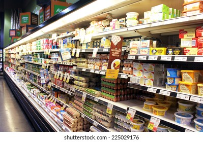 TORONTO, CANADA - SEPTEMBER 13, 2014: Eggs and dairy products on shelves in a supermarket. Egg and dairy are the main sources of protein and calcium.