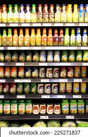 TORONTO, CANADA - SEPTEMBER 13, 2014: Variety of sauces and dressings on shelves in a supermarket. Europe and North America are the leading consumers of sauces, dressings and condiments in the world.
