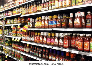 TORONTO, CANADA - SEPTEMBER 13, 2014: Sauces and tomato ketchup bottles on shelves in a supermarket. Europe and North America are the leading consumers of sauces, dressings and condiments in the world