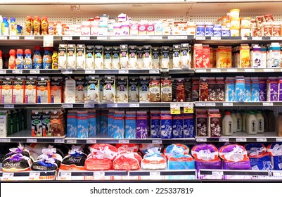 TORONTO, CANADA - SEPTEMBER 13, 2014: Selection of milk and dairy products on shelves in a supermarket. Milk and dairy products are the main sources of protein and calcium.