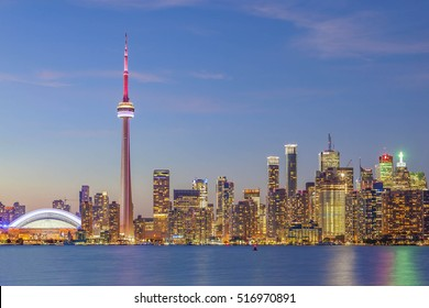TORONTO, CANADA - SEPTEMBER 15, 2015: View of Downtown Toronto skyline illuminated  at sunset.