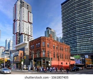 Toronto, Canada - September 16, 2016: The trendy Queen Street West near Peter St. including the Peter Pan Bistro and high rise condo apartment buildings.
