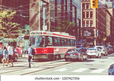 TORONTO, CANADA - SEPTEMBER 17, 2018: Rush hour atToronto's busiest intersections. Financial district at the background.