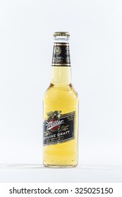 TORONTO, CANADA - SEPTEMBER 26, 2015 : Glass Bottle of Miller Genuine Draft Beer on a bright background in an illustrative editorial image