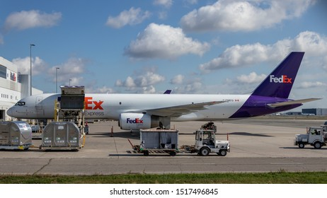 TORONTO, CANADA - September 26, 2019: FedEx Boeing 757-2F being loaded with cargo on a sunny day at Toronto Pearson Intl. Airport.
