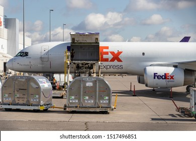 TORONTO, CANADA - September 26, 2019: Front of FedEx Express Boeing 757-2F cargo plane being loaded at Toronto Pearson Intl. Airport.