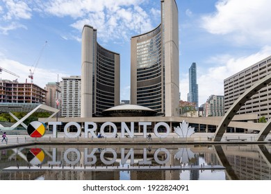 Toronto, Canada - September 29, 2020: New Toronto sign on Nathan Phillips Square is seen with Toronto City Hall in background on September 29, 2020.