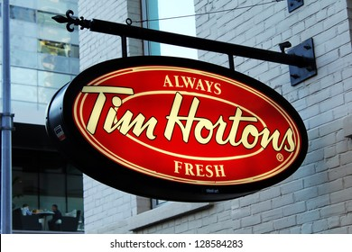 TORONTO, CANADA - SEPTEMBER 9: Close up of the Tim Hortons restaurant sign in downtown Toronto on September 9, 2012. Tim Hortons was founded in 1964 and now it is Canada's largest fast food service.