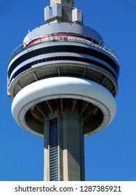 Toronto, Canada-06.12.2017: CN Tower observation deck with thrill seekers. CN Tower was the tallest free standing structure in the world for a long time. Concrete communication tower. Popular landmark