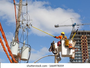 Toronto, Canada-10 February, 2020: Contractor at work fixing electric lines