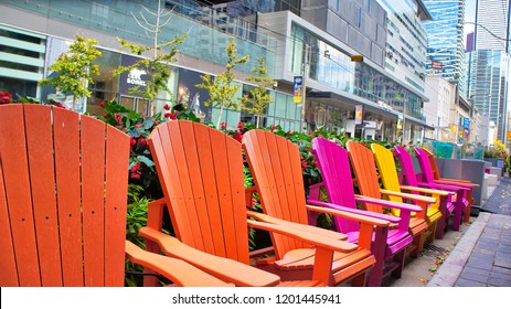 Toronto, Canada-12 October, 2018: Colorful chairs on King street in front if TIFF (Toronto International Film Festival) entrance