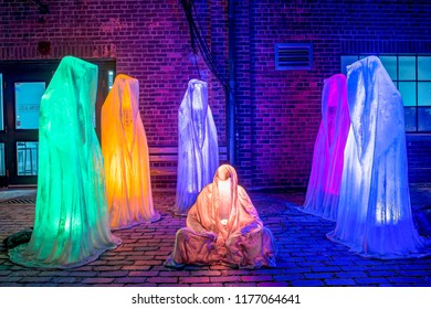 Toronto, Canada-December 20, 2018: Light Festival at the Historic Distillery District. Guardians of Time by Manfred Kielnhofer. The event is a visual adventure which has become a tourist attraction