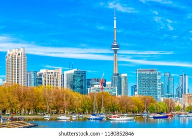 Toronto, Canada-July 10, 2018: Skyline of the Canadian city in the daytime. Both the skyline and the CN Tower are major tourist attractions in the city