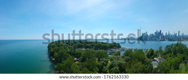 Toronto Central Islands and Ward's Island Park beach, Ontario, Canada, aerial view from top at sunny greenery coast with boats and downtown gta at summer. Popular tourist location.