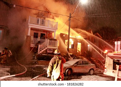 TORONTO - CIRCA JANUARY 2010 - Firefighters battle a four alarm fire involving three homes in the Beach neighborhood of the city.