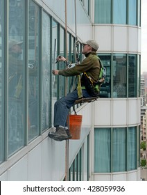 TORONTO, CIRCA MAY 2016.  Window washers on skyscrapers, as hazardous as the job appears, still attracts many people who can manage their fear of heights as illustrated in a newer building in Toronto.