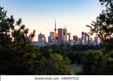 Toronto city center skyline during evening golden hour sunset seen from Riverdale Park East