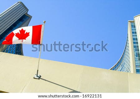 Toronto City Hall Buildings, Canadian Flag. Composed with intention to leave a copy space in the middle of frame for your additions.