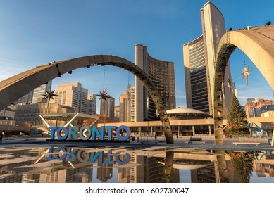 Toronto City Hall on Nathan Phillips Square at sunset, Canada.