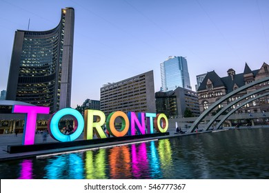 Toronto city hall and Toronto Sign in downtown at twilight, in Toronto, Ontario, Canada
