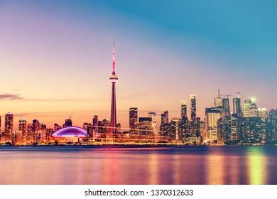 Toronto city skyline and lake Ontario at night. Canada