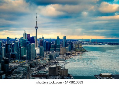TORONTO CITY SKYLINE AT SUNSET - Amazing aerial shot of downtown Toronto with business buildings at sunset. Winter cityscape of big city, dense urban core, and waterfront. Toronto, Ontario, Canada