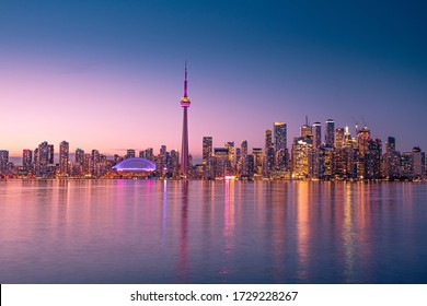 Toronto city view at night after the sunset. The view from Center Island in Lake Ontarion