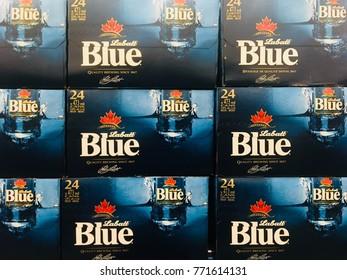 TORONTO - DEC 9, 2017: Labatt Blue, a popular Canadian brand of beer, in cases.