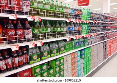 TORONTO - DECEMBER 14: Bottled soft drinks in a supermarket on December 14, 2013 in Toronto. From 1977 to 2002, Americans doubled their consumption of sweetened beverages.