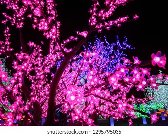 TORONTO - DECEMBER 2018:  The trees at the Ontario Place waterfront park are festooned with colorful LED decorations for a Christmas and winter festival.
