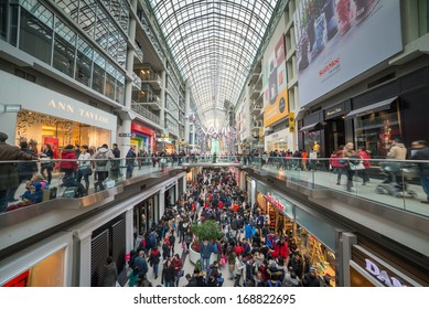 TORONTO - DECEMBER 26: Shoppers visit the mall in Toronto, Canada on  Boxing Day, December 26, 2013.