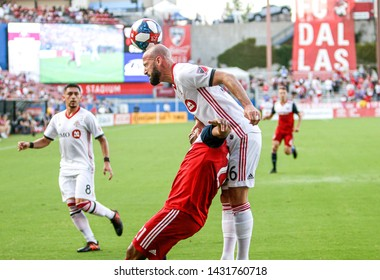Toronto FC defender Laurent Ciman (26) heads the ball over FC Dallas midfielder Michael Barrios (21) during a MLS match a between Toronto FC and FC Dallas June 22, 2019, at Toyota Stadium, Frisco, TX.