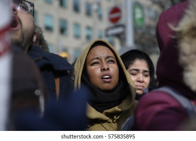 TORONTO - FEBRUARY 4:  A Muslim girl chanting slogan during a protest in front of the US Consulate to denounce Donald Trump's immigration policies on February  4, 2017 in Toronto, Canada.