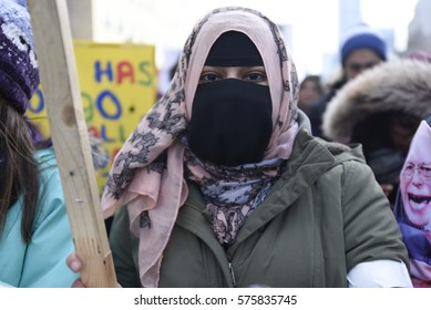TORONTO - FEBRUARY 4: A  Muslim woman wearing burqa during a protest in front of the US Consulate to denounce Donald Trump's immigration policies on February  4, 2017 in Toronto, Canada.