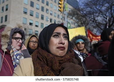 TORONTO - FEBRUARY 4: A Muslim woman crying after hearing the names of the victims of the Quebec mosque attack during a rally in front of the US Consulate on February  4, 2017 in Toronto, Canada.