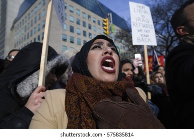 TORONTO - FEBRUARY 4:  A Muslim woman chanting slogan during a protest in front of the US Consulate to denounce Donald Trump's immigration policies on February  4, 2017 in Toronto, Canada.