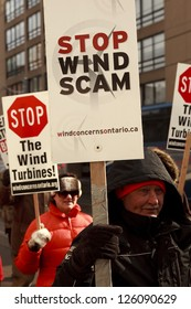 TORONTO - JAN  26 : industrial wind turbines Protesters  marching to Liberal Leadership convention in Toronto  January 26 2013 1 in Toronto, Canada.