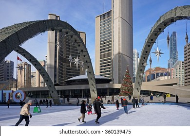 TORONTO - JANUARY 2016:  The skating rink at City Hall decorated for Christmas is a popular pastime, as seen in Toronto in January 2016.
