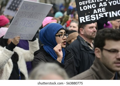 "TORONTO - JANUARY 21: A Muslim girl wearing Hijab shouting slogans during the ""Women's March on Washington"" to protest against Trump presidency on January 21, 2017 in Toronto, Canada."