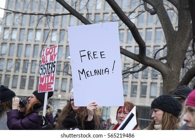 "TORONTO - JANUARY 21: Protesters with signs where they are mockingly asking to free Melania Trump"" during the ""Women's March on Washington""  on January 21, 2017 in Toronto, Canada."