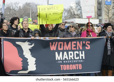"""TORONTO - JANUARY 21:  Women walking  while shouting slogans during the """"Women's March on Washington"""" to protest against Trump presidency on January 21, 2017 in Toronto, Canada."""