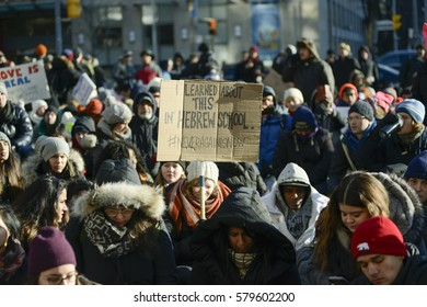 TORONTO - January 30: People sitting on the street during a protest in front of the US Consulate to denounce Donald Trump's immigration policies on January  30, 2017 in Toronto, Canada.