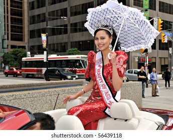 TORONTO - JULY 01:: Miss Beauty of Asia 2010 rides on convertible car during Canada Day parade in Toronto, July 01, 2010