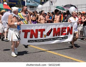 TORONTO - JULY 04: Totally Naked Toronto Man enjoying nudity at Pride parade in Toronto, July 04, 2010