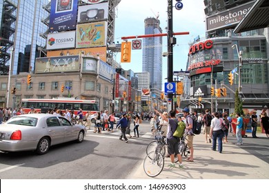 TORONTO - JULY 12: Traffic on Yonge Street on July 12, 2013 in Toronto. Yonge Street was formerly listed in the Guinness Book of Records as the longest street in the world at 1,896 km (1,178 mi).