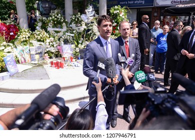 TORONTO - JULY 30 :Prime Minister Justin Trudeau  speaking to media while paying tribute to the victims of Danforth mass shooting in Toronto, Canada on July 30, 2015 in Toronto, Canada.